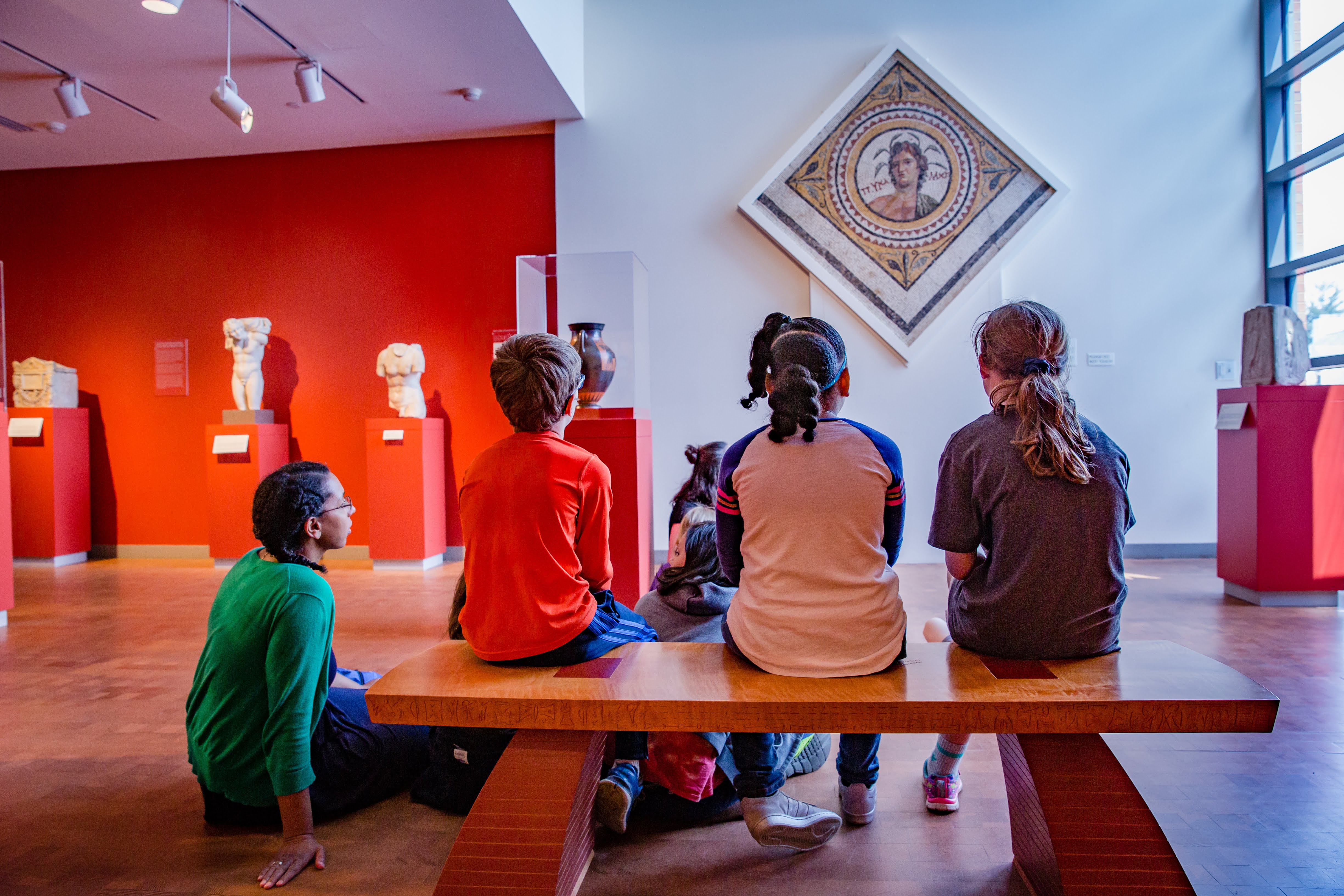 students viewing artwork at the museum