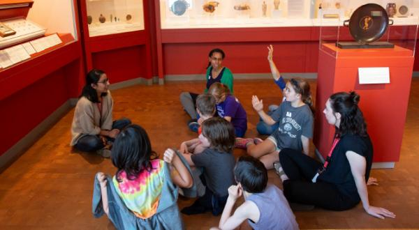 Students learning at a museum
